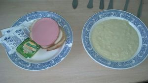 Breakfast.  Oatmeal, some kind of bologna and two pieces of bread with butter.
