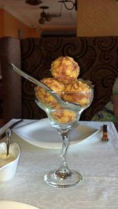 Cheese balls with ham and melted cheese inside.  Delish.  Love the presentation!